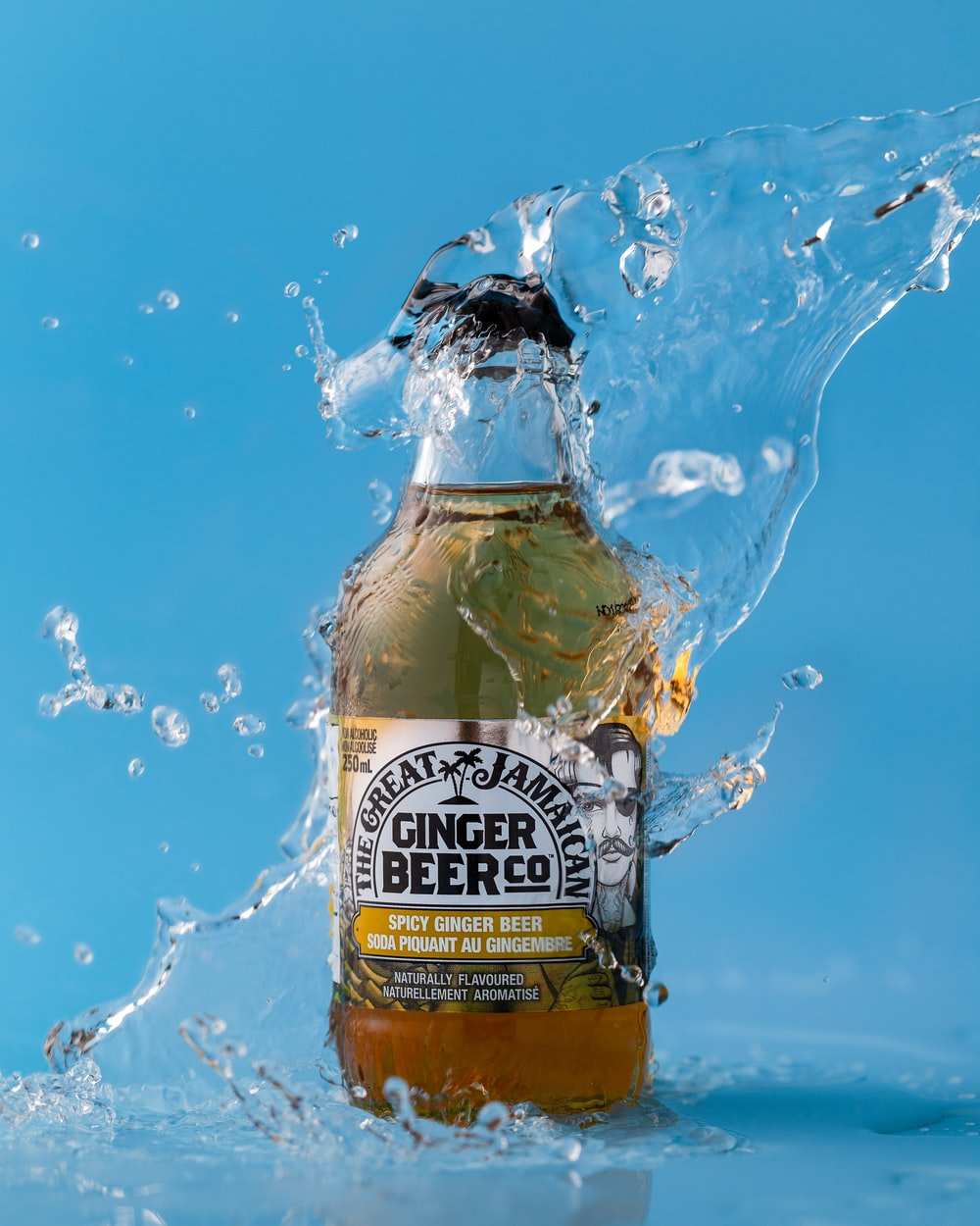 water splashing on Ginger Beer Co bottle
