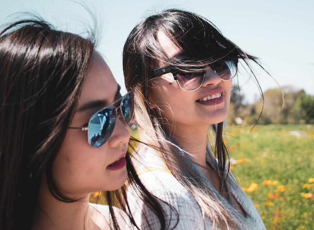 two women wearing shades
