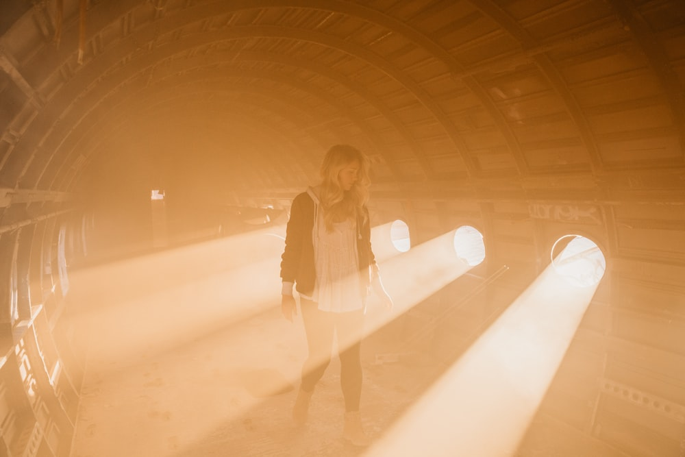 woman standing inside room with spotlights