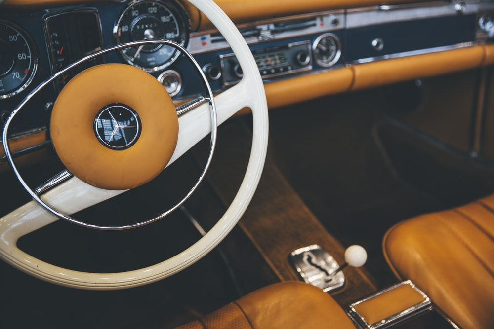 black and yellow Mercedes-Benz vehicle interior