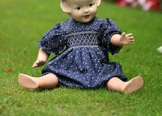 plastic girl doll sitting outdoor