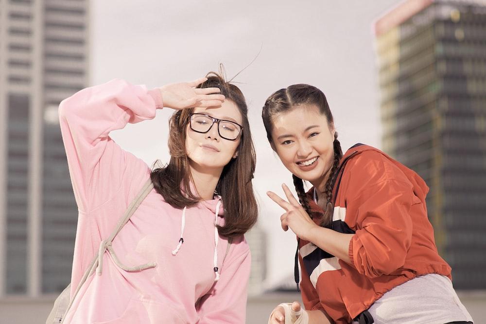 two women taking selfie outdoor