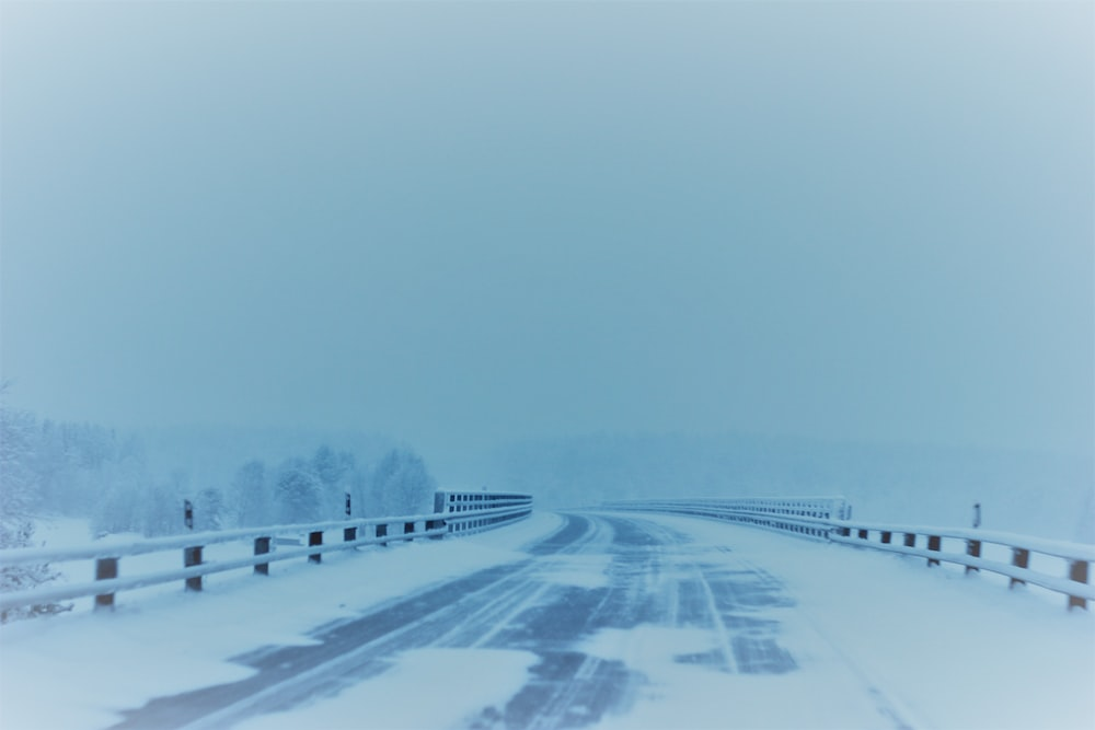 snow covered empty road