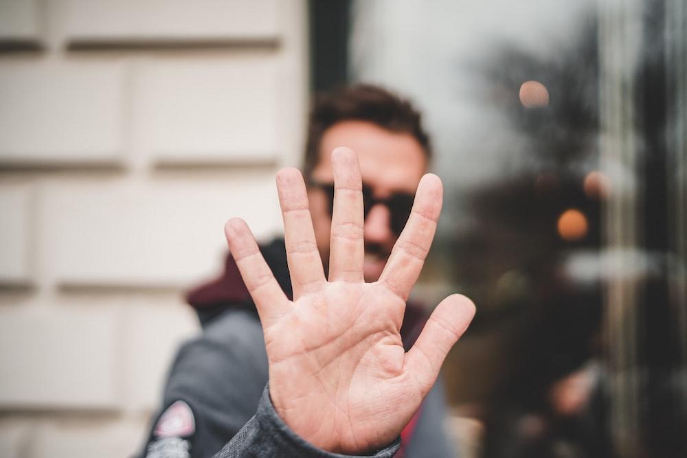 man raising right hand