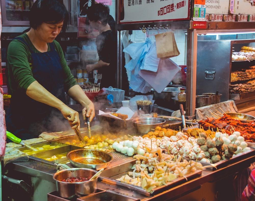 woman cooking street foods
