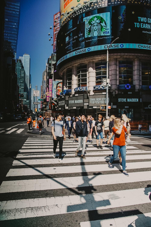 people on pedestrian lane during daytime