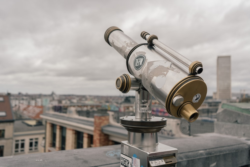 selective focus photo of gray and brown telescope
