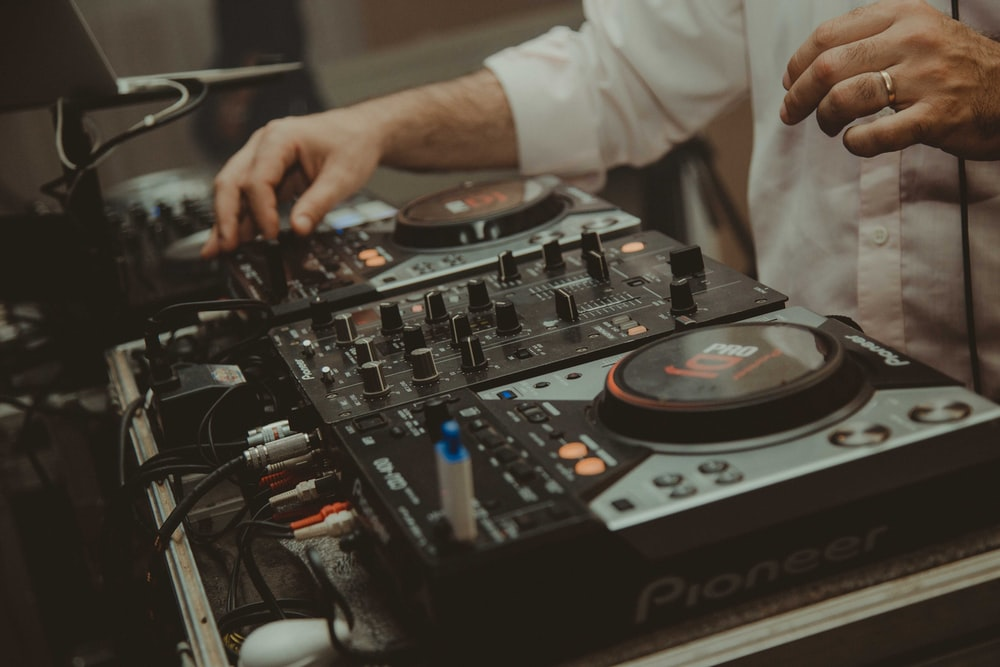 man operating DJ controller