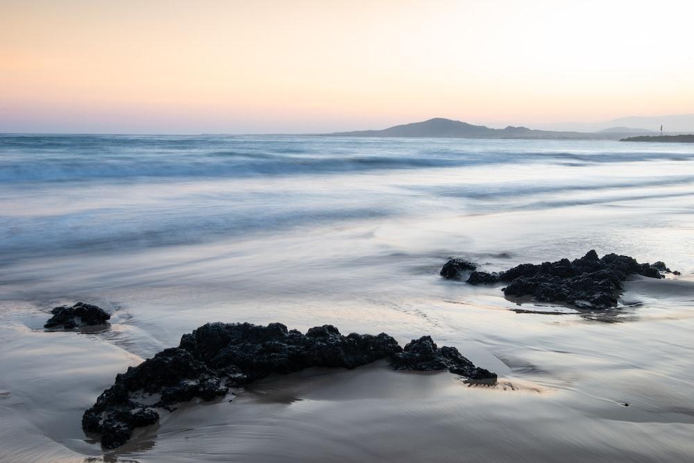 coastal rocks during daytime