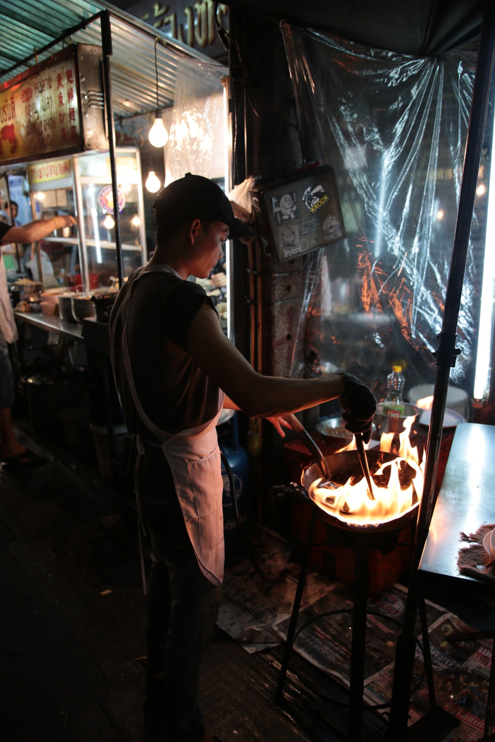 man standing while cooking