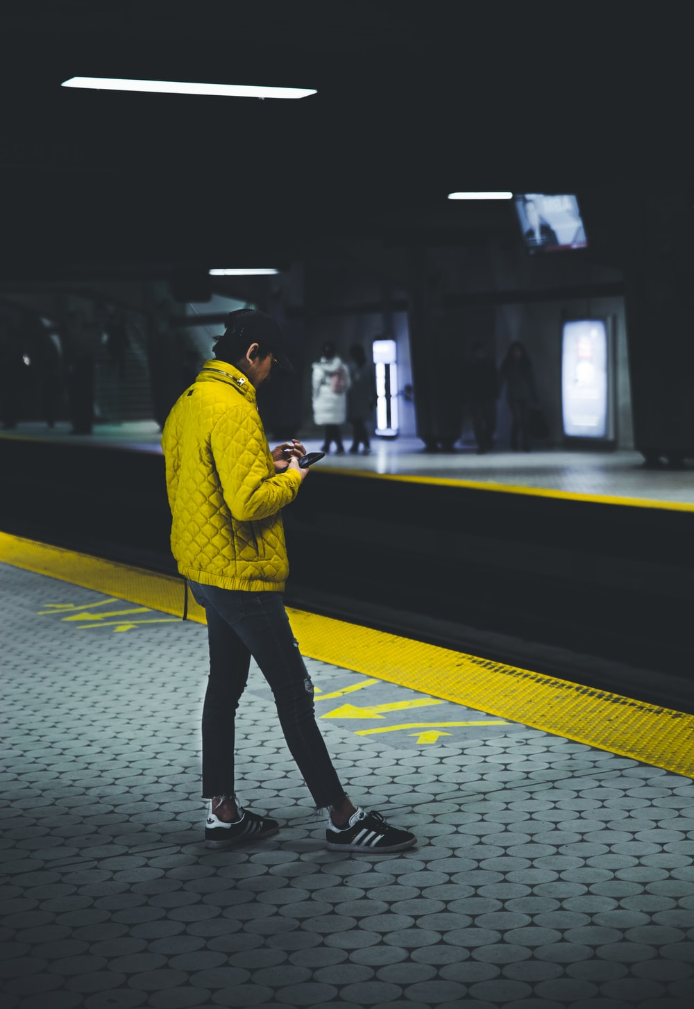 man standing wearing yellow jacket
