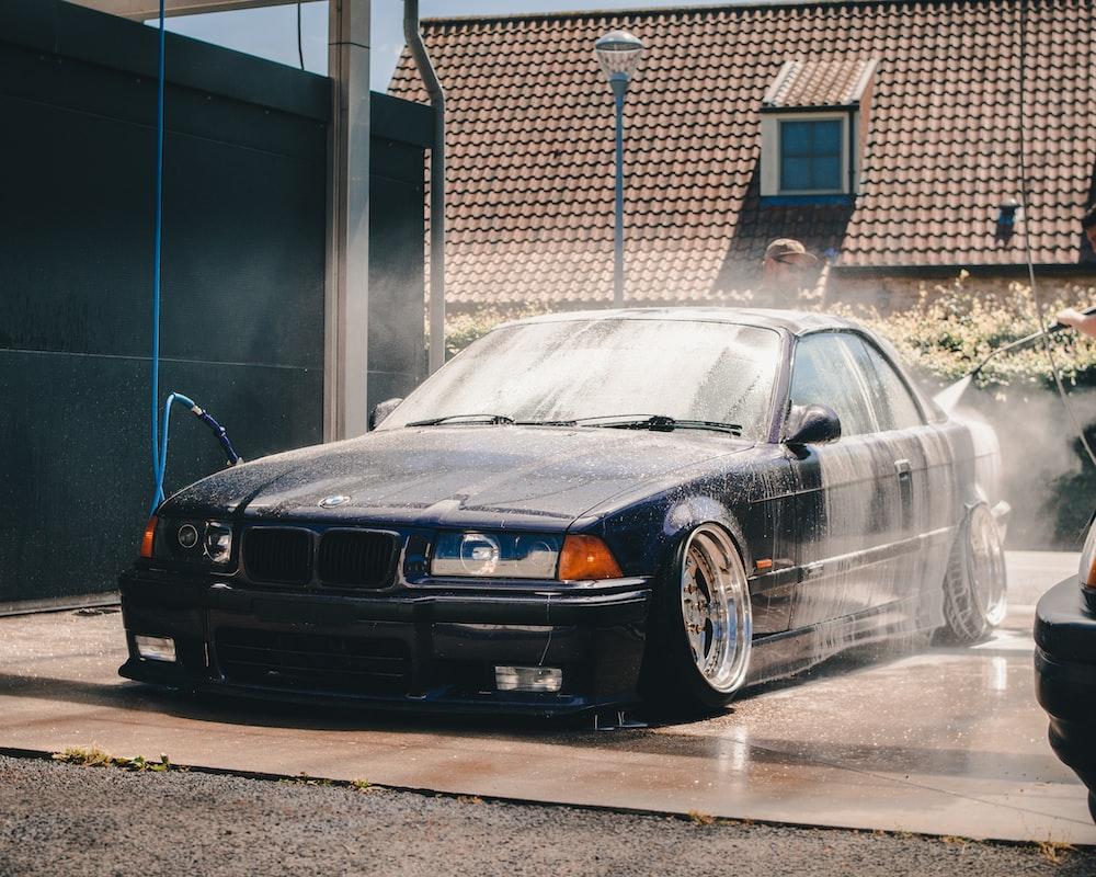 black BMW E36 on car wash