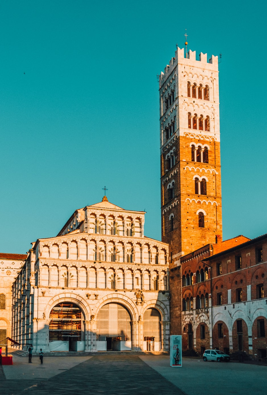 tall orange and white buildings in Lucca, Italy