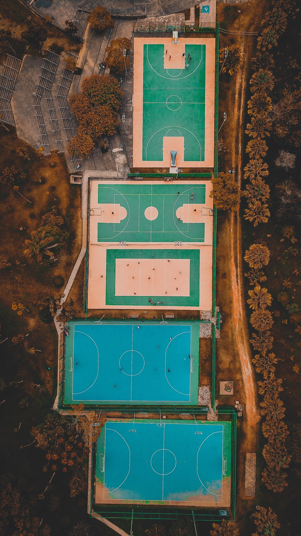 five blue and green floored sports court aerial view