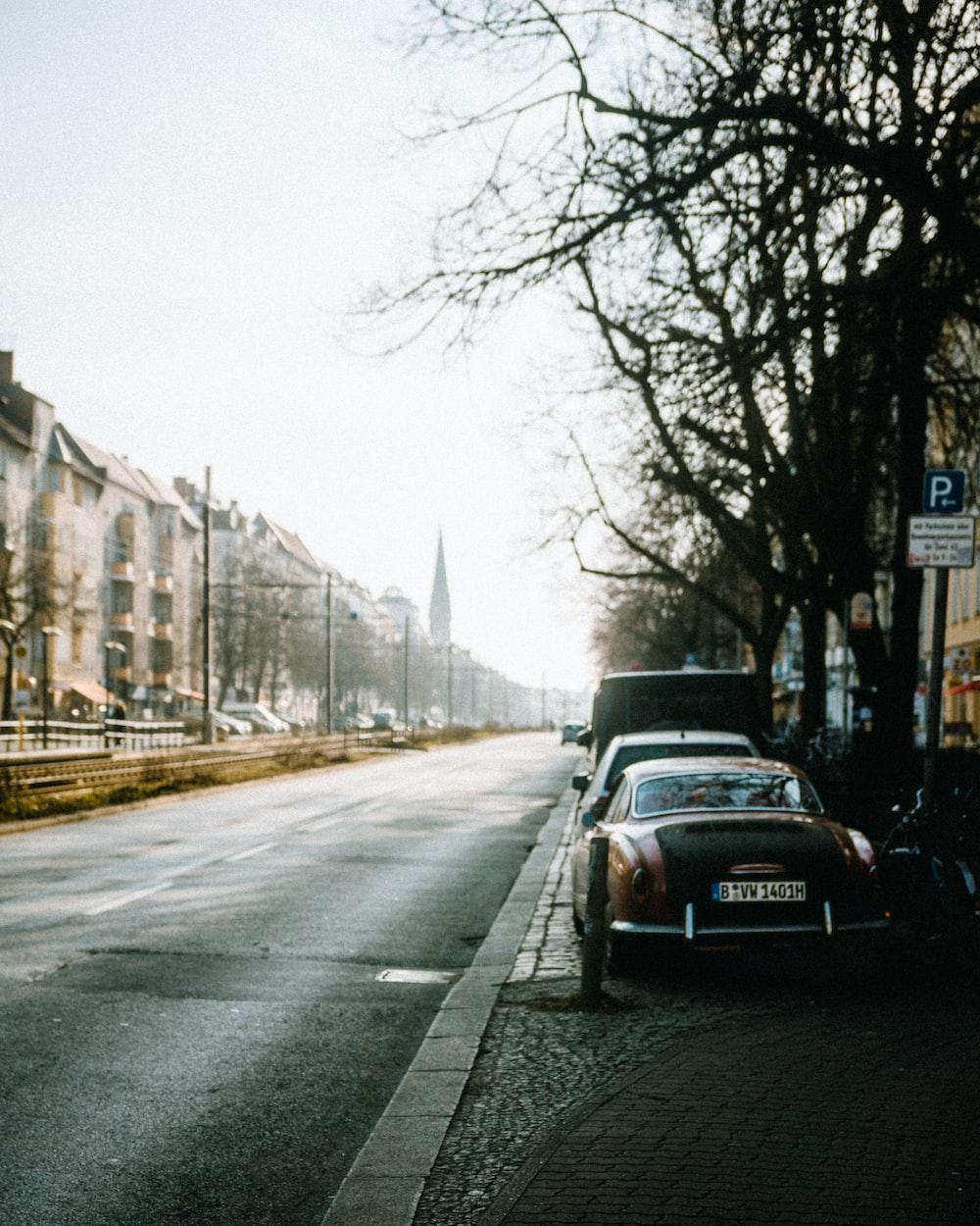 vehicles on roadside during daytime