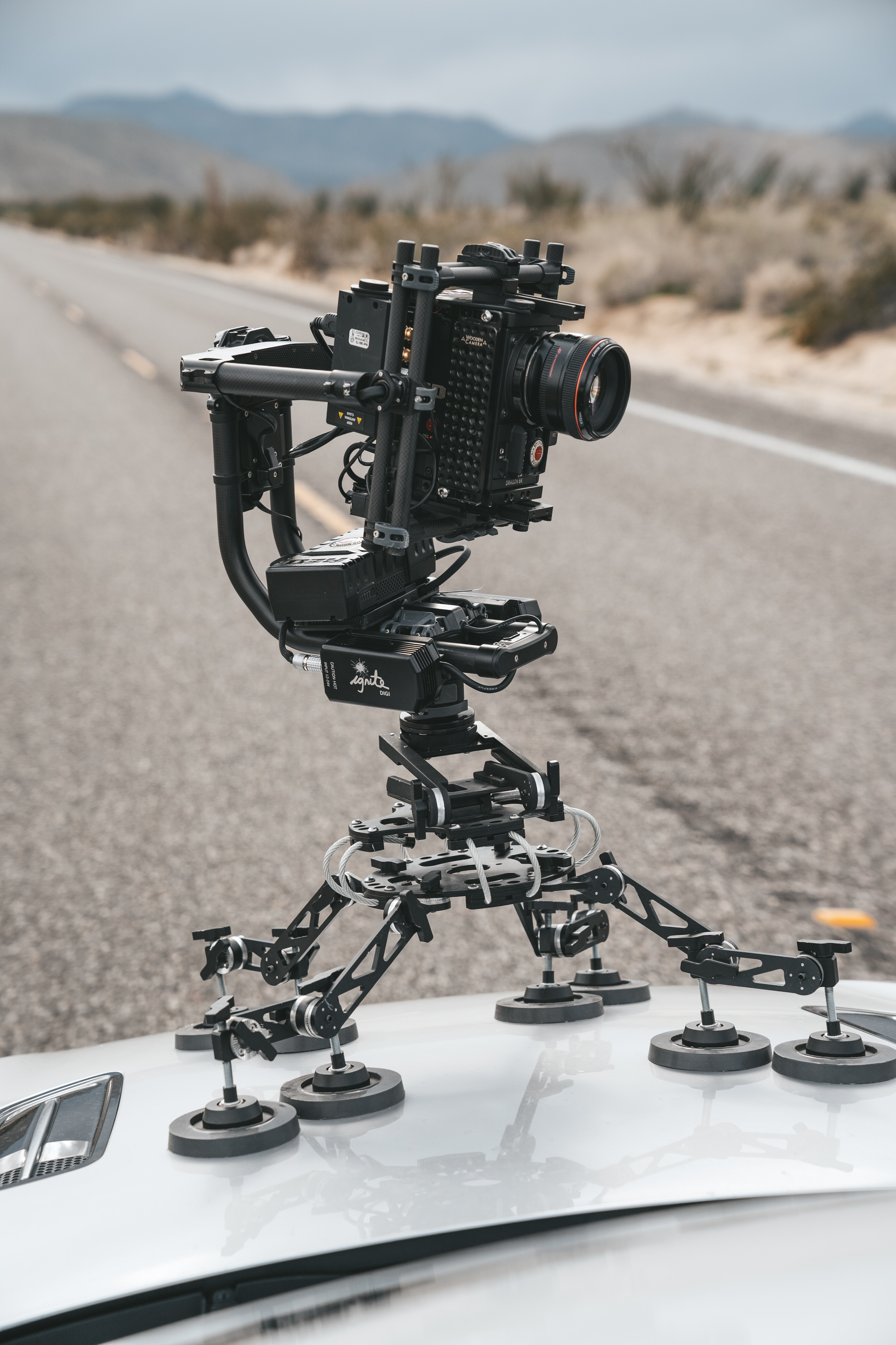black and gray camera stand on top of car hood