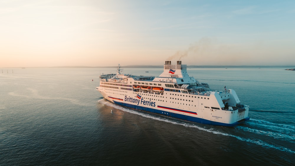 white and blue Brittany Ferries ferry sailing at the bay