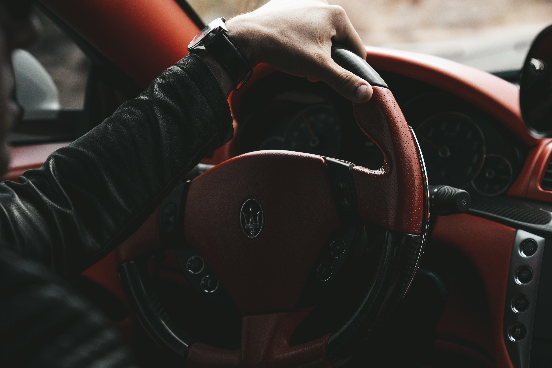man driving Maserati car