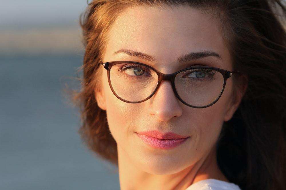 woman wearing eyeglasses and pink lipstick