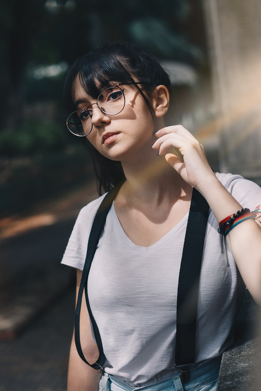 selective focus photography of woman wearing white top and black suspenser