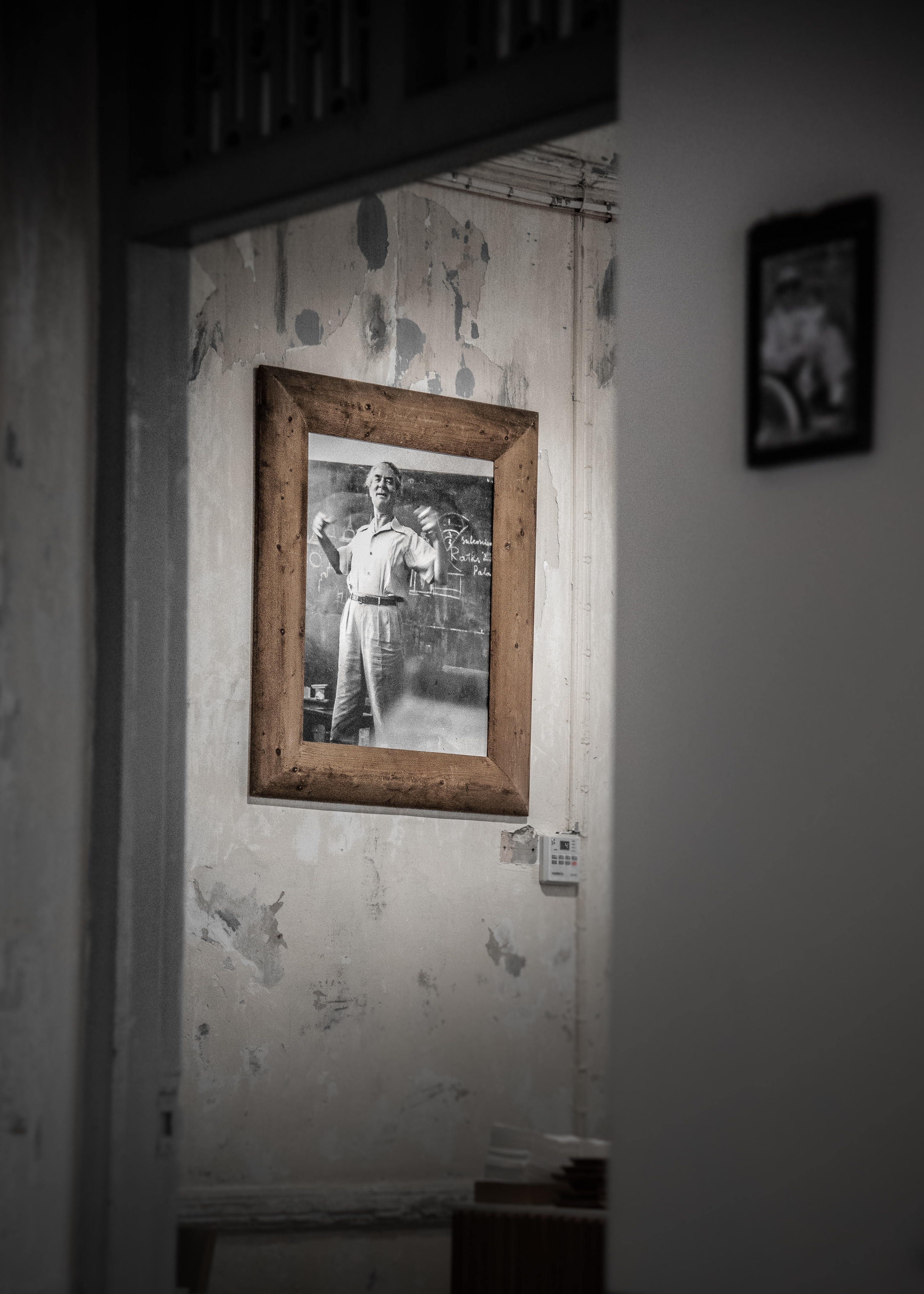 man in long-sleeved and pants framed photo on wall