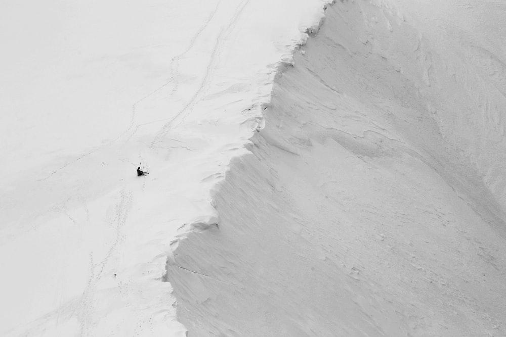 person in white snow hill