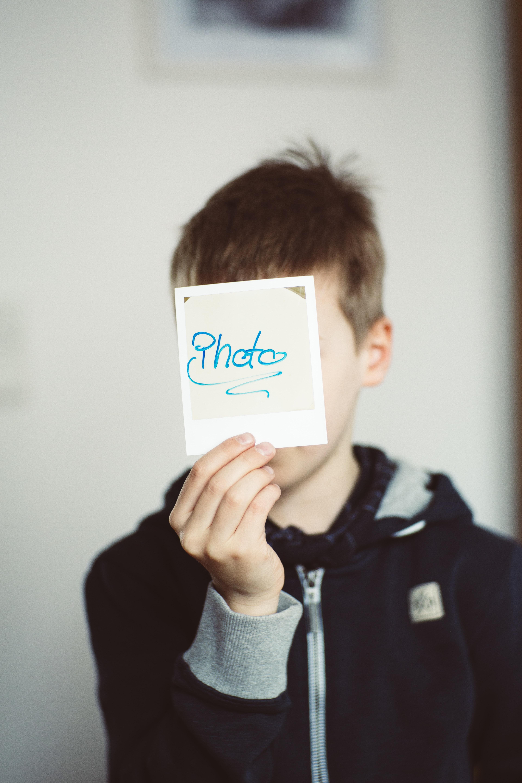 boy holding photo paper