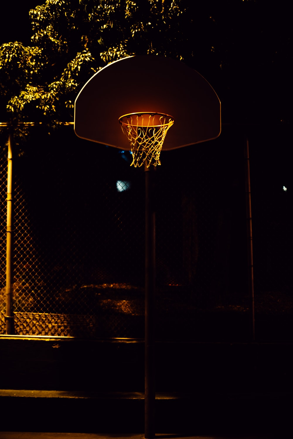 brown and white basketball hoop with net
