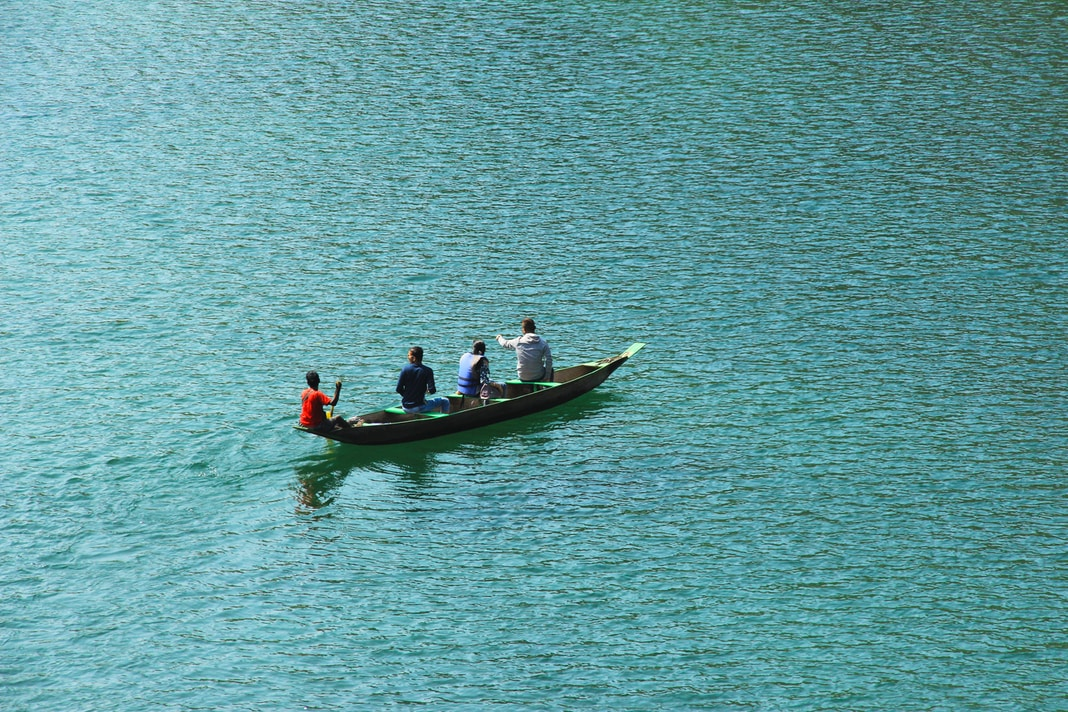 four person boating on body of water