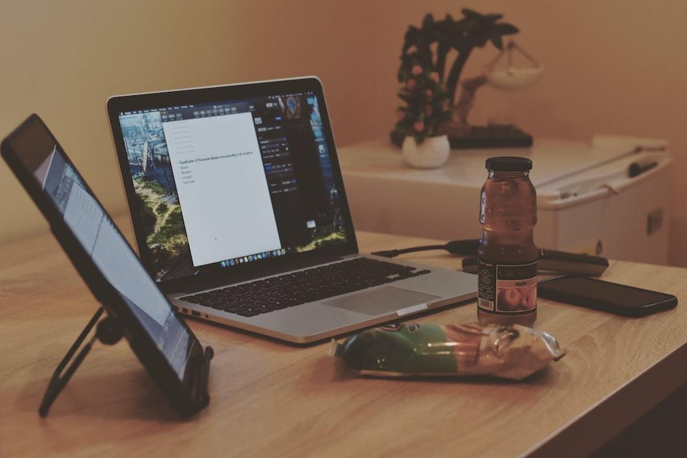 MacBook Pro beside tablet computer