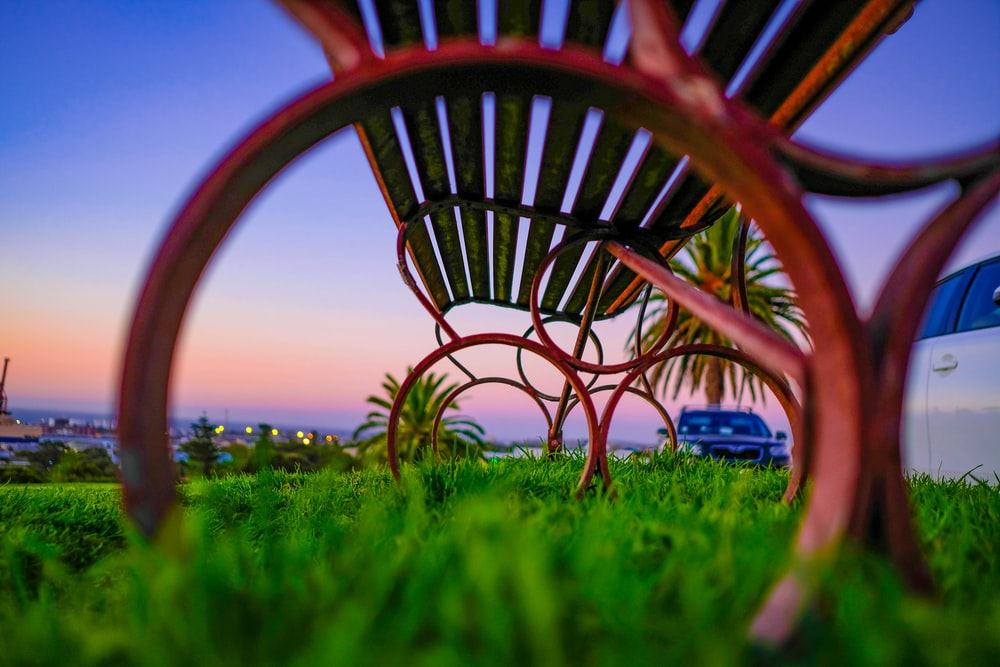 selective focus photography of red bench