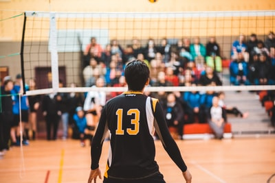 man wearing black 13 volleyball jersey volleyball zoom background