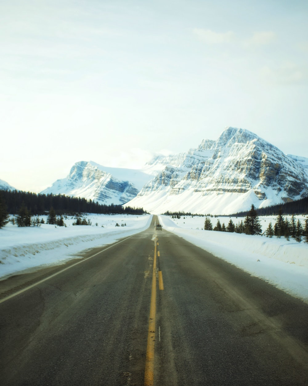 road leading towards snowy mountain