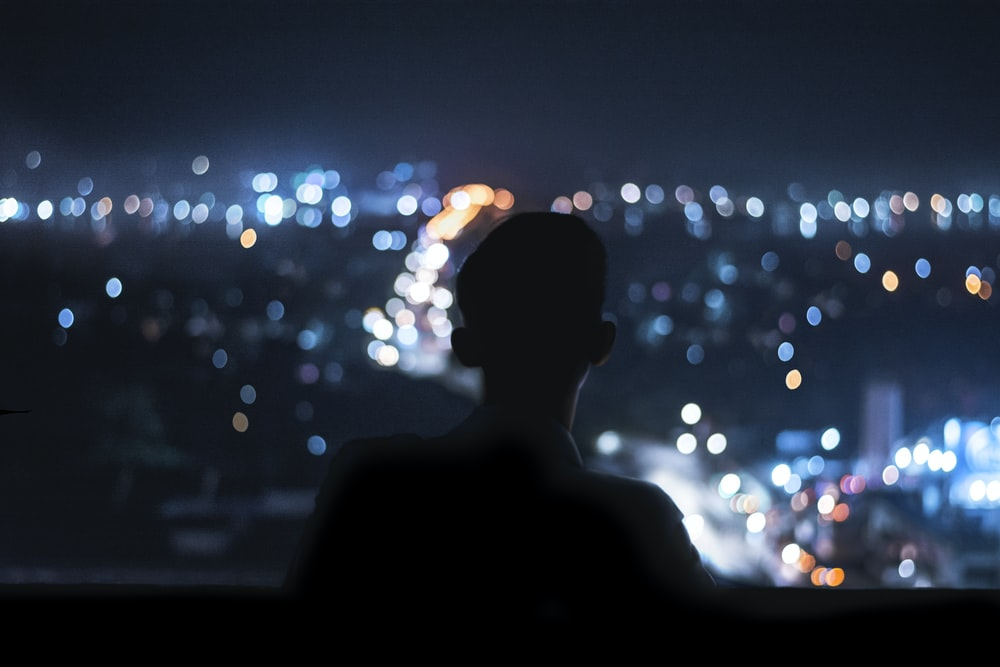 silhouette of person during night time