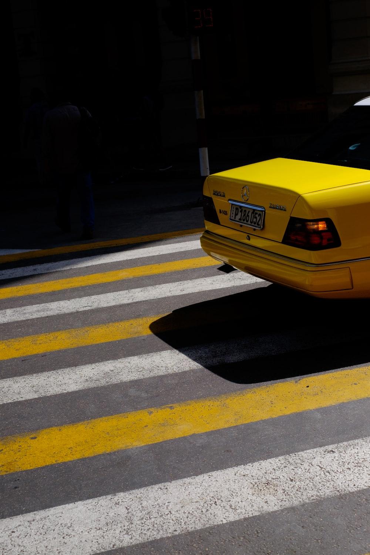 yellow vehicle passing on pedestrian lane
