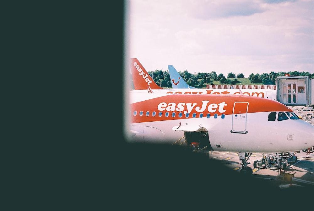 white and orange Easy Jet plane