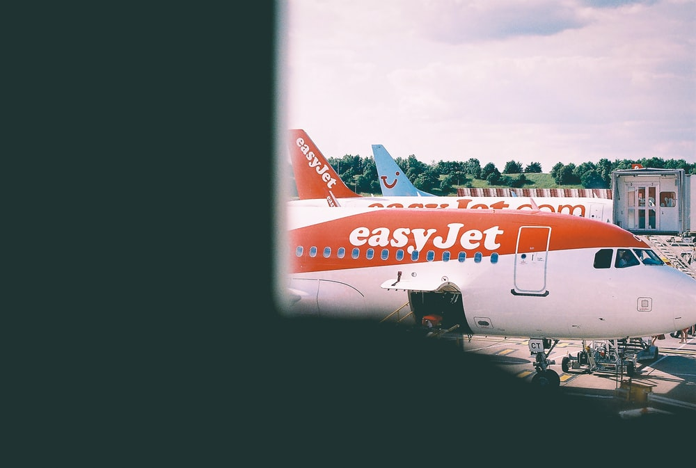 white and orange Easy Jet plane