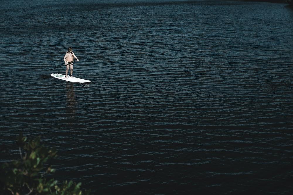 man riding boat at water