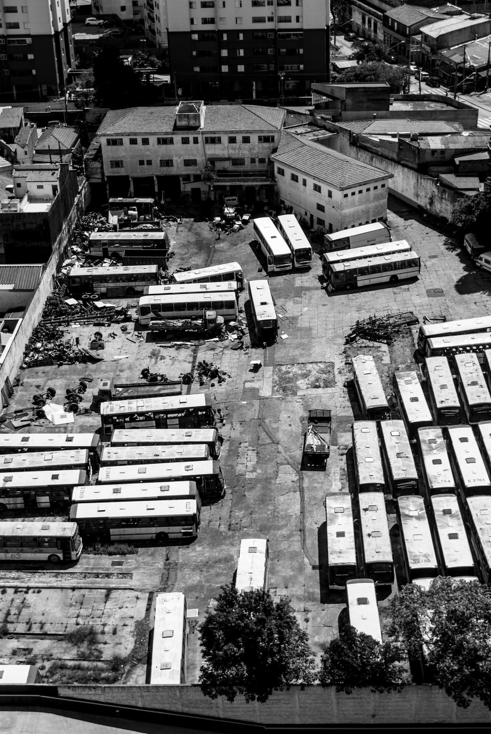 greyscale photo of aerial view of buses