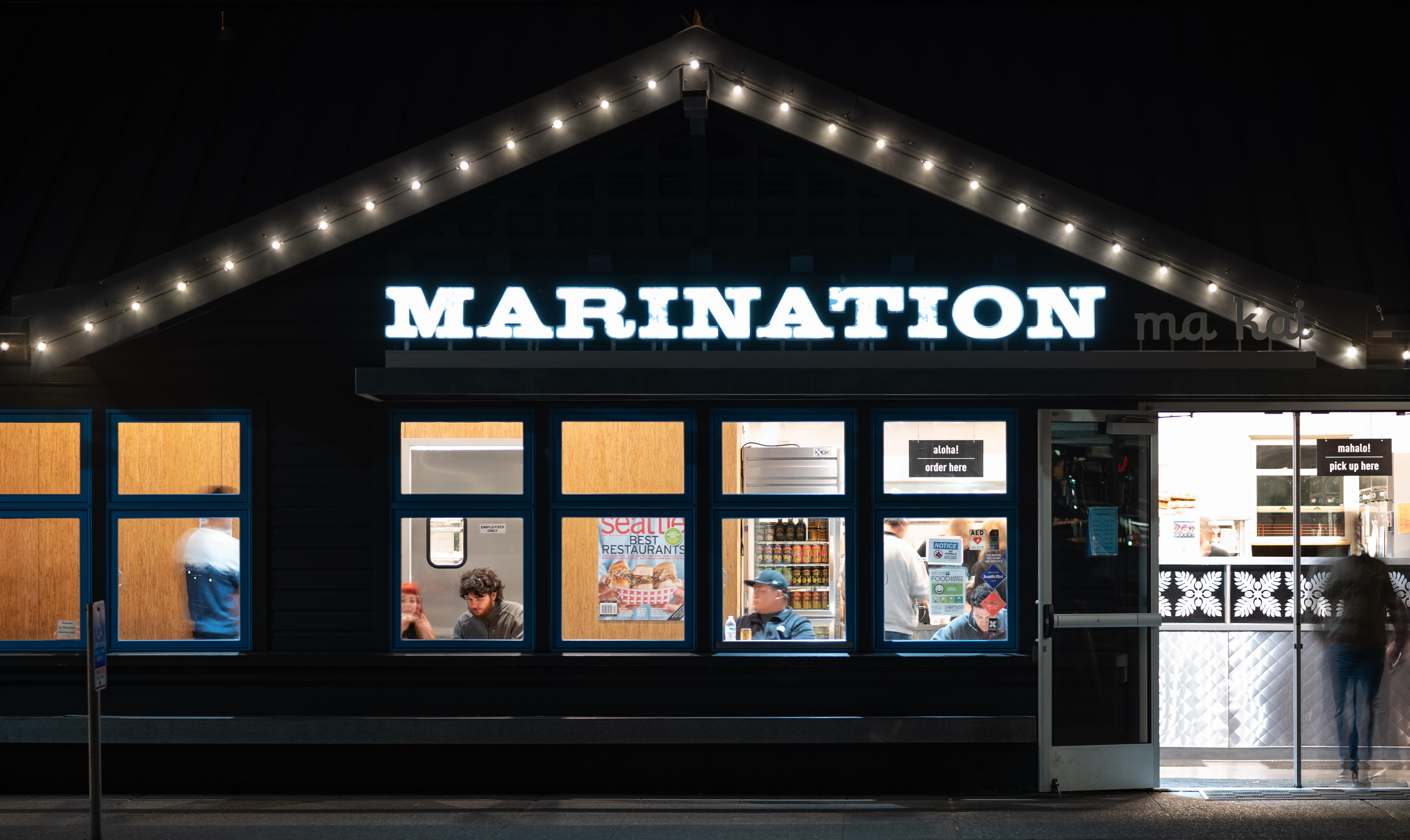 Marination store facade at night