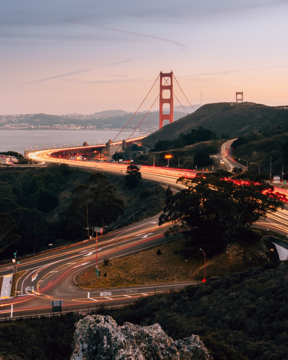 time-lapse photography of cars on road by Golden Gate Bridge