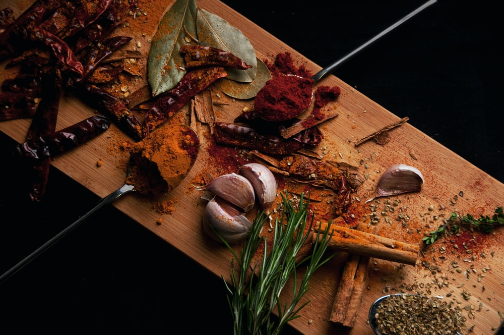 sliced food additives on brown cutting board