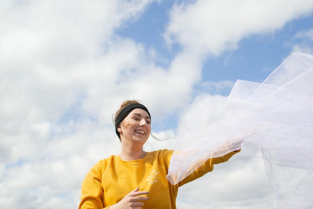 woman holding white veil