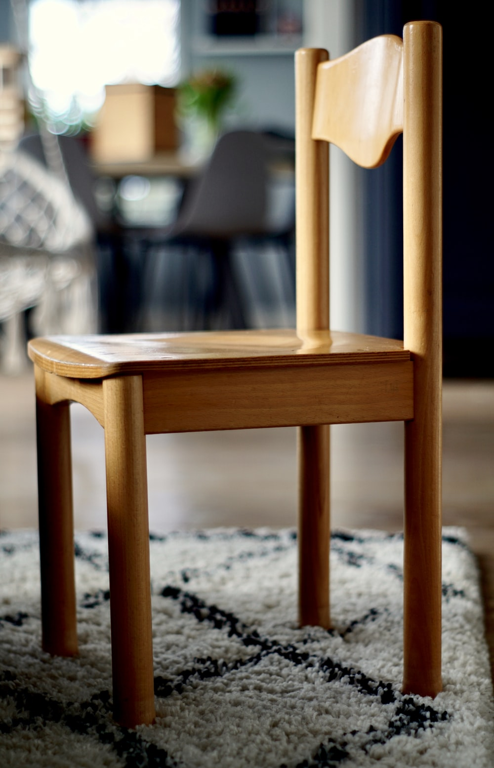 selective focus photo of brown wooden chair