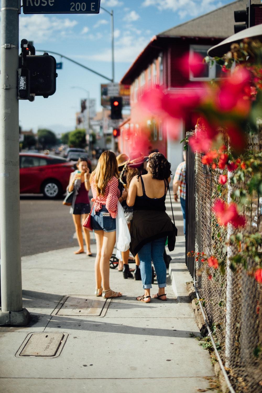 woman standing near the street light post