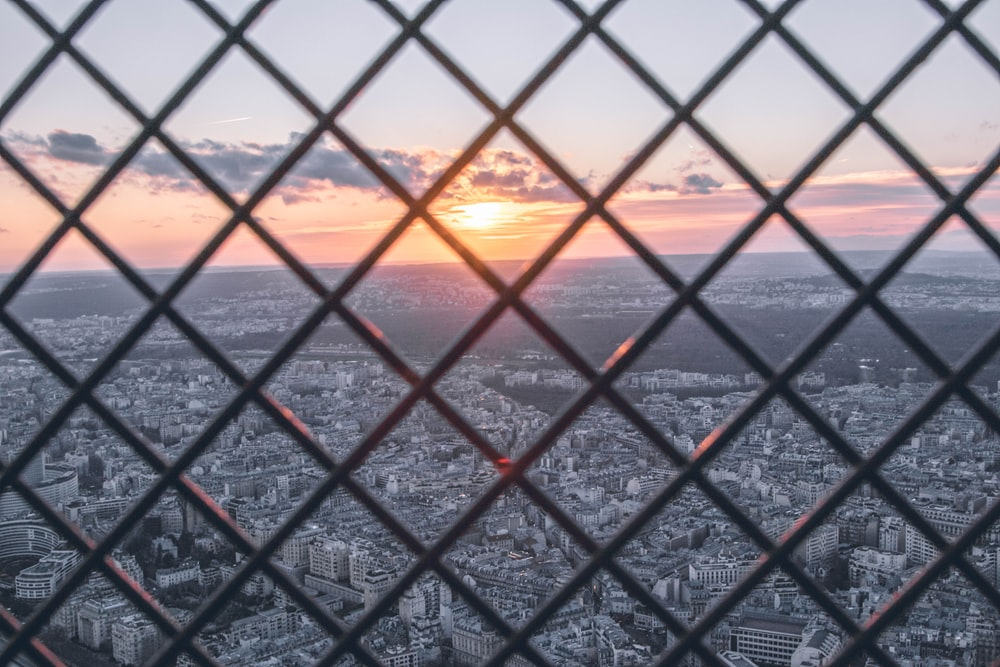 cyclone fence top-view on buildings during sunset