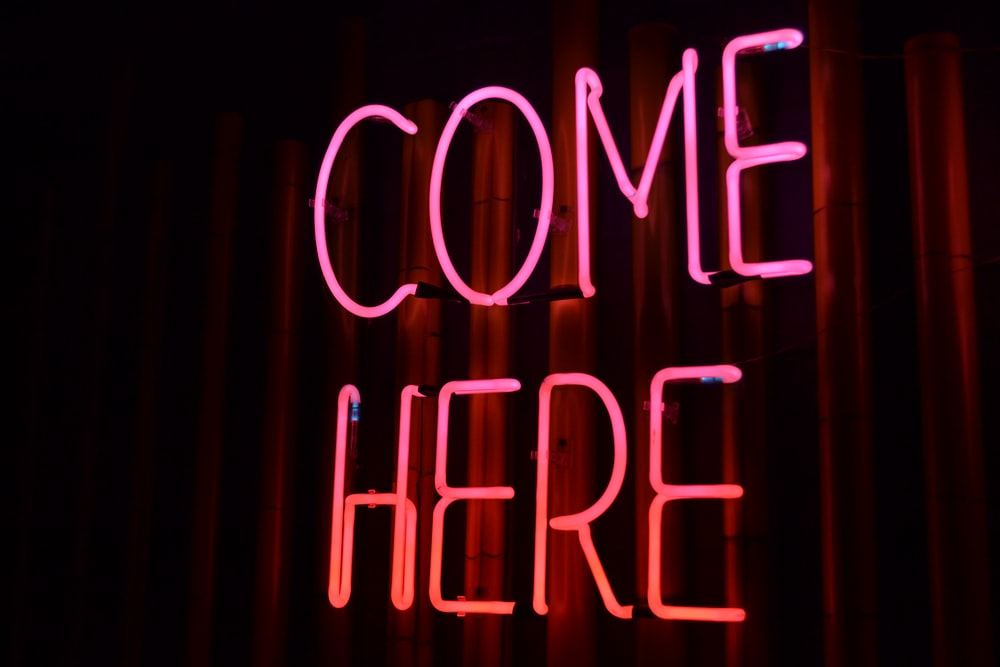 lighted come here neon sign