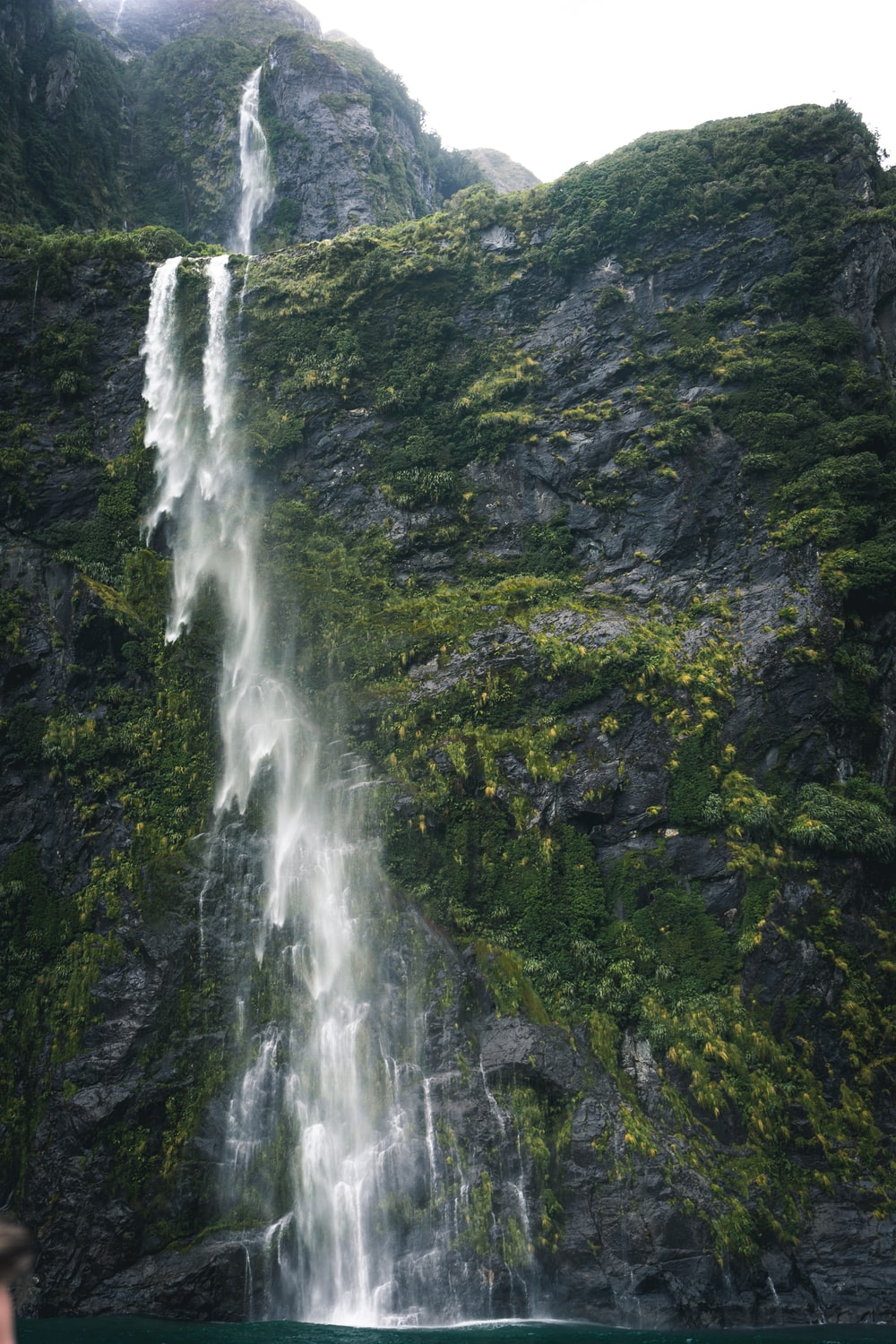 water falls by the mountain