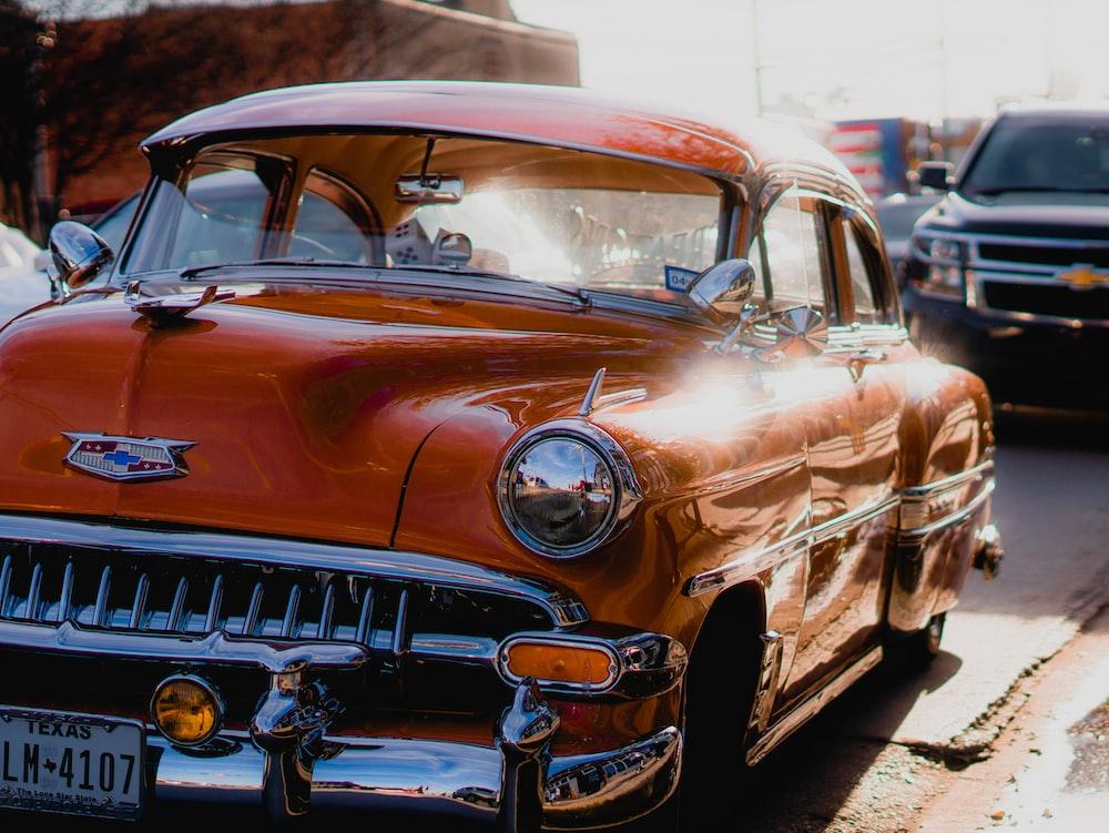 orange Cadillac vehicle