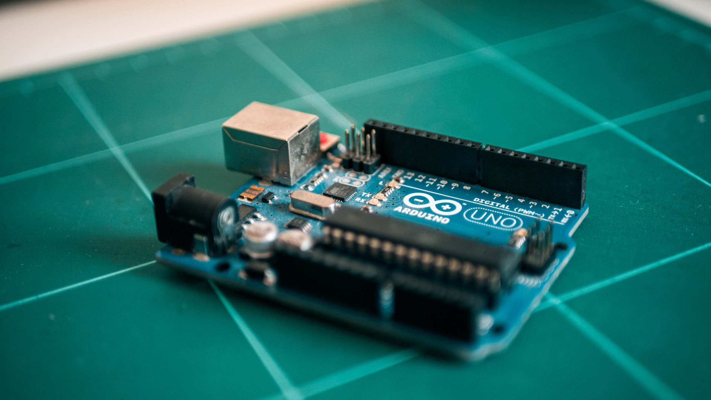 Arduino Uno on bench by Harrison Broadbent